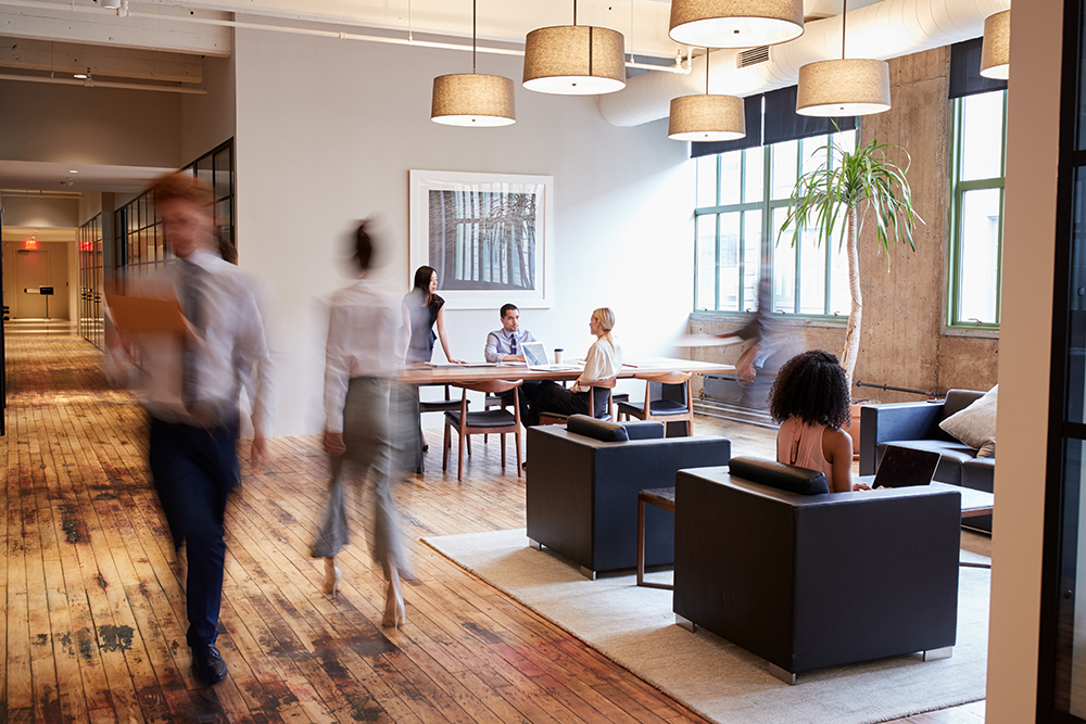 Employees bustling about in energy-efficient office building