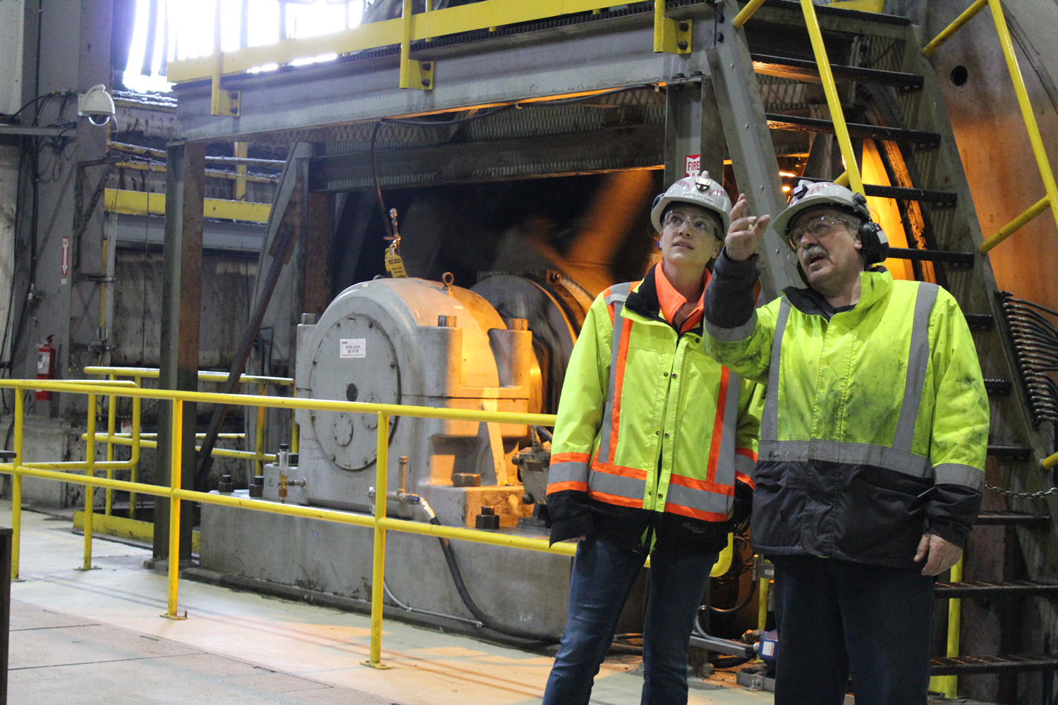 Two employees discussing efficiency of equipment at GoldCorp