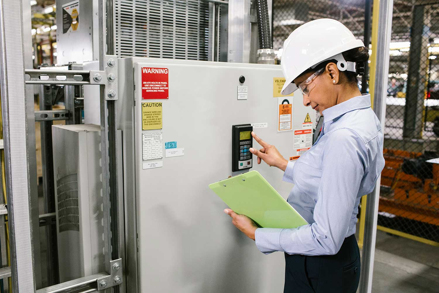 Energy manager inspecting variable frequency drive