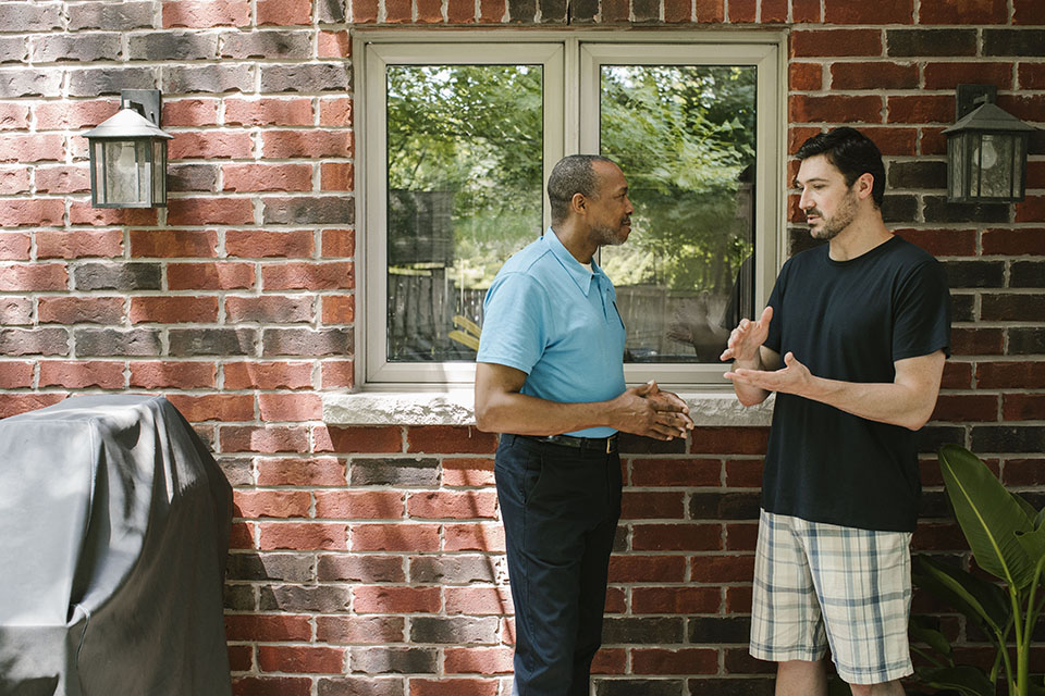 Homeowner receiving advice from energy auditor