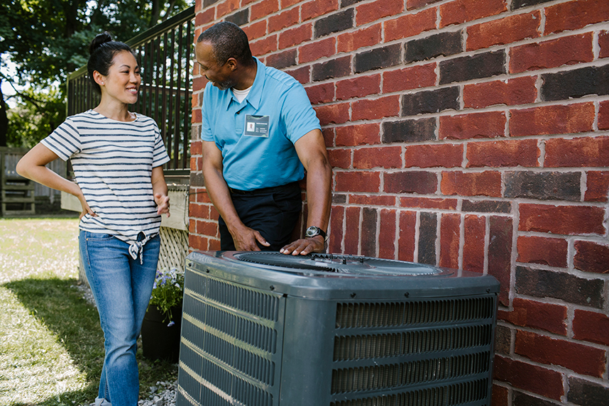 Homeowner receiving advice about her air conditioner from a contractor