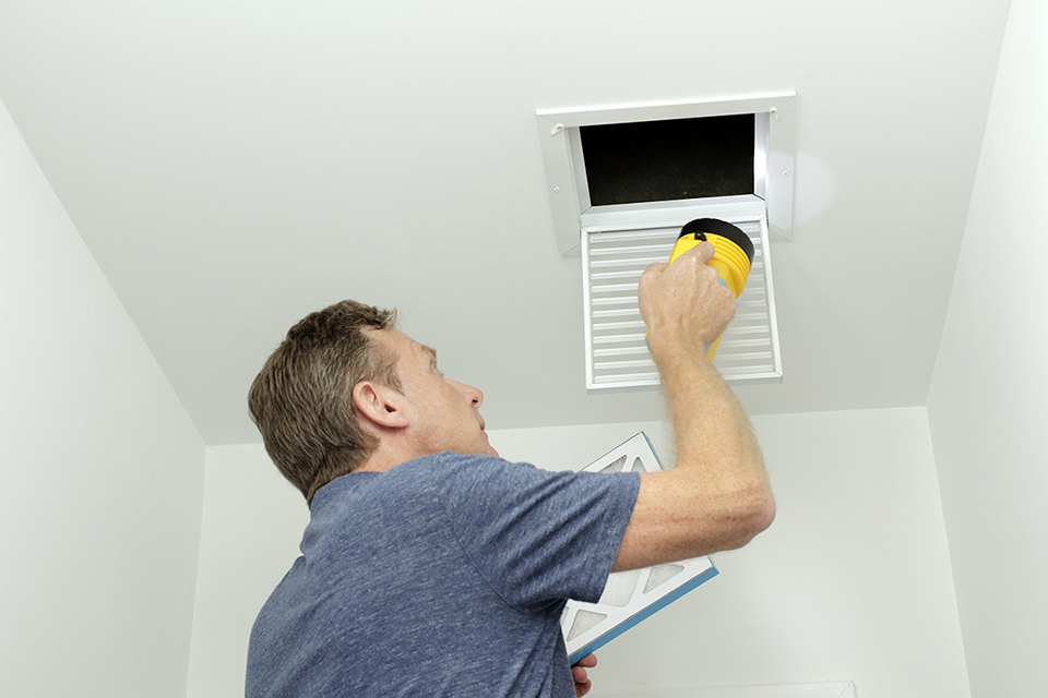 Contractor preparing to clean air ducts
