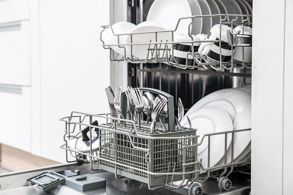 dishwasher ready to be unloaded, with clean dishes