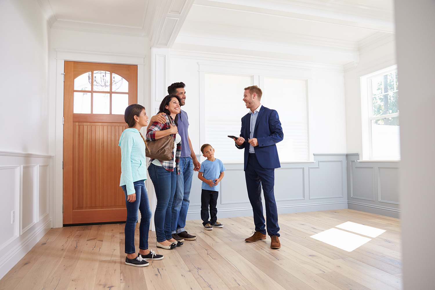 realtor showing family an open house