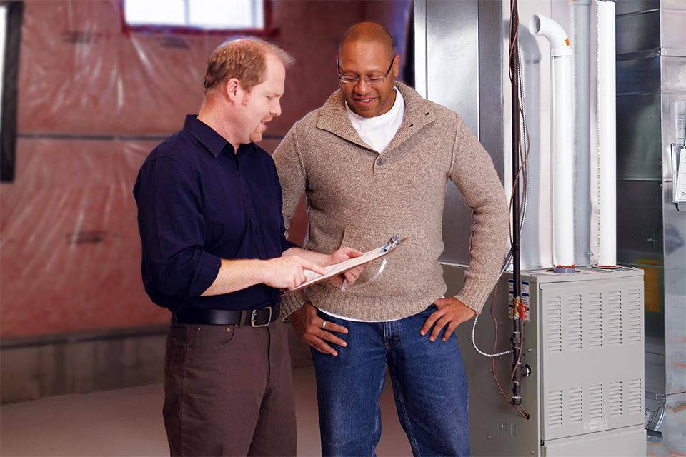 Contractor sharing information to homeowner about his furnace