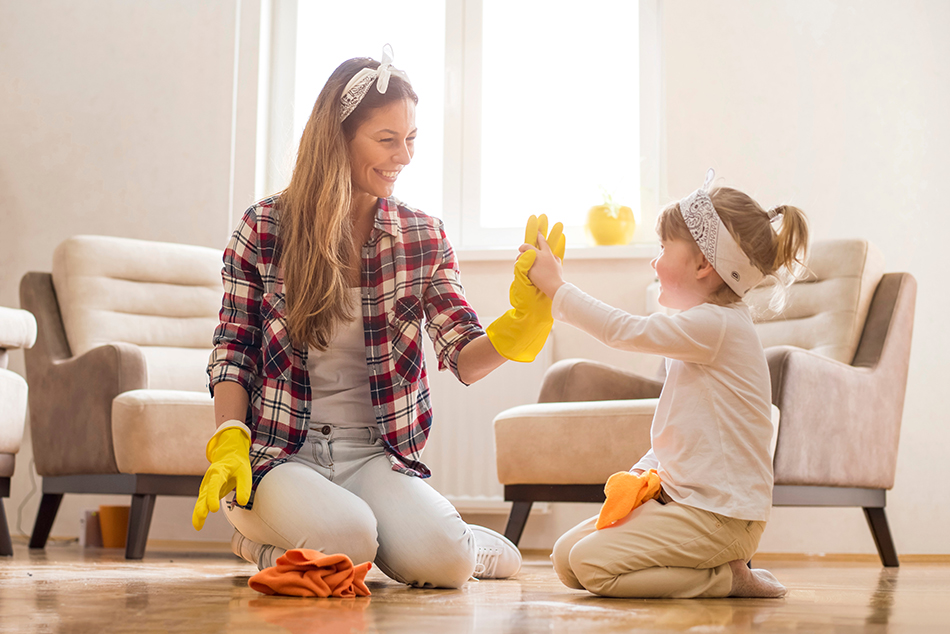 mother and daughter are cleaning to help reduce their allergies