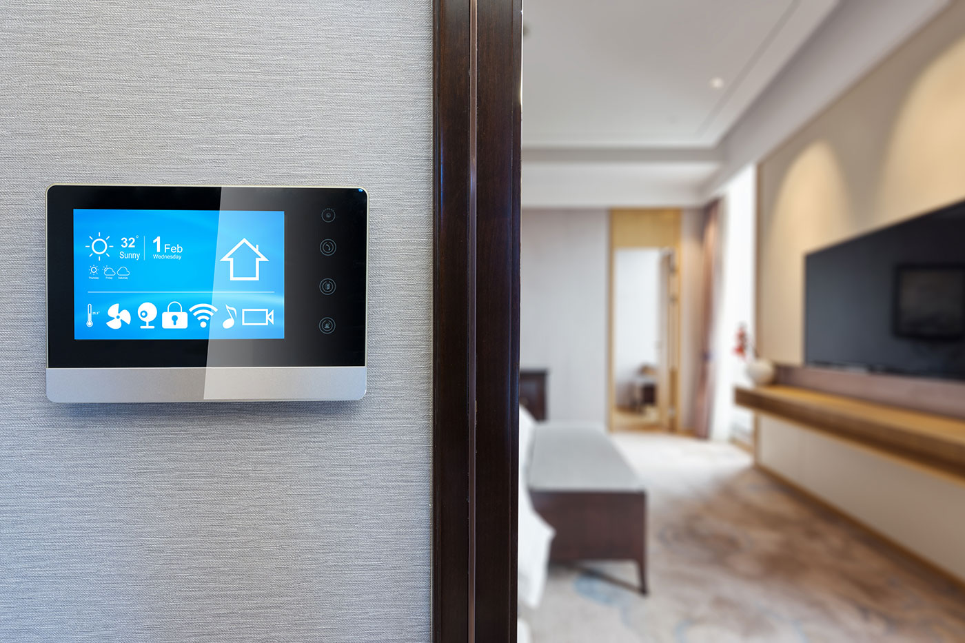 a smart thermostat that has been place on an interior wall of a home