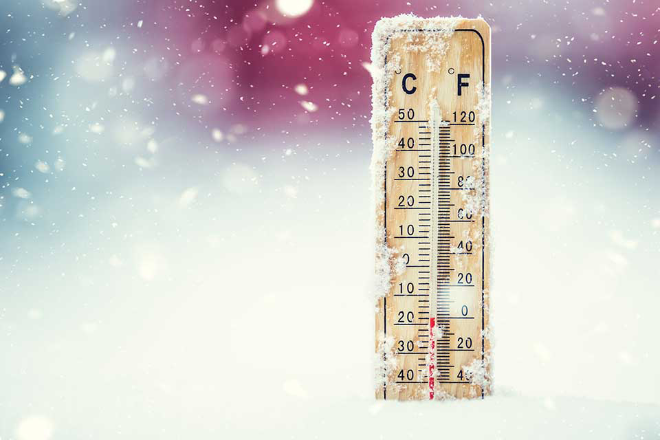 a thermometer in the snow shows the importance of bringing potential customers in from the cold